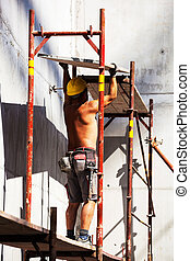 construction worker on a job site - construction workers on...