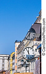 austria, linz, main square. with clock 11:55