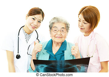 Asian doctor and senior woman - Senior woman with medical...