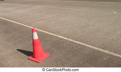 Orange Traffic Cone - Orange traffic cone on the side of the...