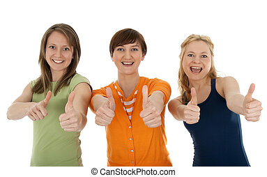 Three happy young women giving thumbs up - Three happy and...