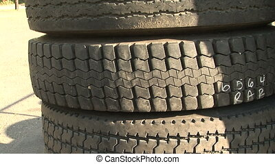 Tower of Old, Used Tires - Used car tires stacked high, zoom...