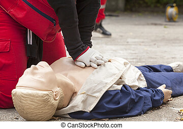 First aid - Paramedic demonstrates CPR on dummy
