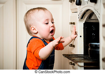 Unguarded baby with open oven - Dangerous situation - little...