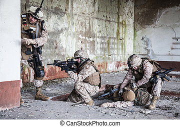 Fighting marines - Squad of US marines in ruined building