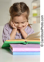 Cute little girl with a book