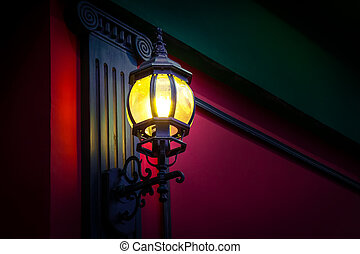 Street lamp - Vintage street lamp at the evening on red wall...