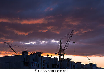 Silhouette of building crane - Silhouette of construction...