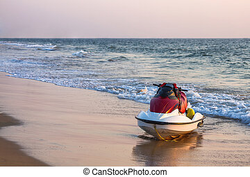 Jet ski on the beach near the ocean
