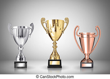 trophies - golden, silver and bronze trophies on gray...