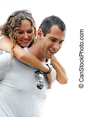 beautiful woman on shoulders of smiling handsome man