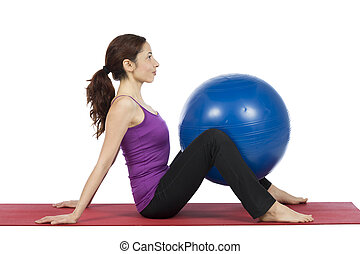 Woman with a pilates ball - Woman is doing exercises with a...