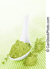 Wheatgrass powder. - Detox. Wheatgrass powder on white spoon...