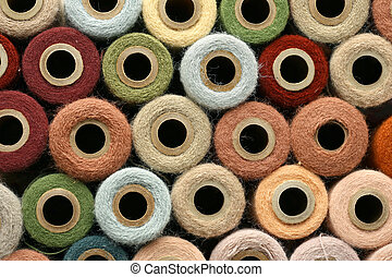 Collection of Natural Colored Vintage Yarn Spools Background...