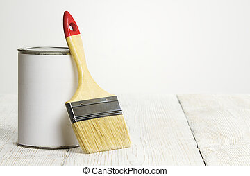 Paintbrush and can, paint brush and white color container on...