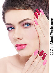 Fancy pink manicure - Close-up portrait of young beautiful...