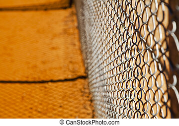 Chainlink Fence - Chainlink fence on a baseball field with...