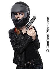 Woman in biker helmet with gun