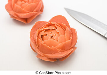 Carved Carrot Flowers - Two flowers carved from carrots,...
