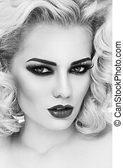 Smoky eyes - Black and white close-up portrait of young...