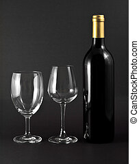 wine - A bottle of red wine and two elegant glasses on black...