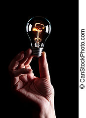 taking bulb - human hand taking a light bulb