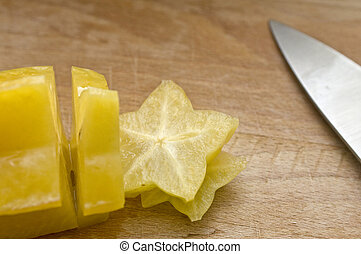 Sliced Starfruit - Yellow starfruit freshly sliced on a...