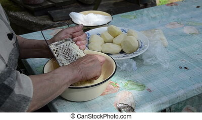 old woman grater potato