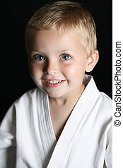 Karate Kid - Blond boy with blue eyes in karate uniform
