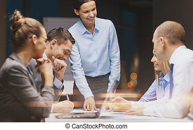 smiling female boss talking to business team - business,...