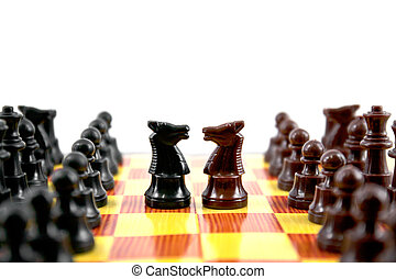 chess - fighting between brown and black knights on chess...