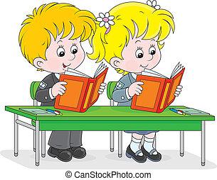 Schoolchildren read at a lesson