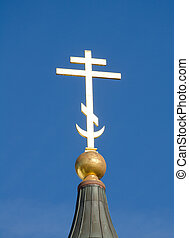 Cross on the dome of the Orthodox Church.