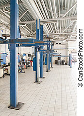 Lifts for cars in service center.