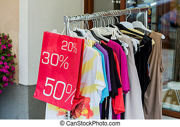sale - action end of the season in a textile shop