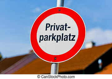private - sign indicates a private parking lot of a house...