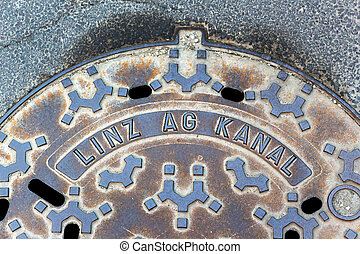 channel of linz ag - a manhole cover from linz ag for water...