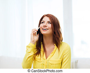 smiling woman with smartphone at home - home, technology and...