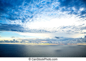 Nightfall - A beautiful cloudy sunset over the ocean