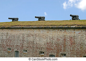 Three Cannons - three civil war era cannons sit atop a wall...
