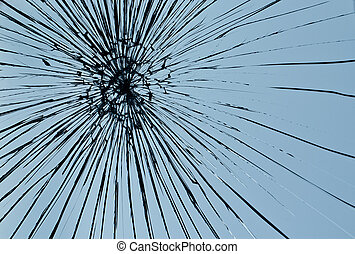 Broken window pane - Cracked glass against a blue sky...