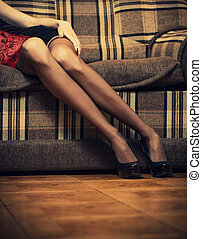 sexy legs - sexy female legs in high heels at vintage sofa