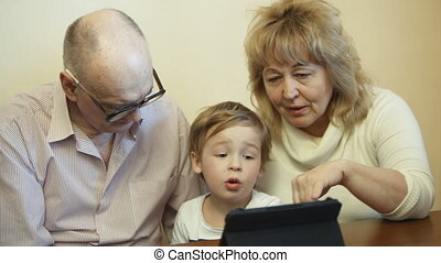 Family time with touchpad - Grandparents and their grandson...