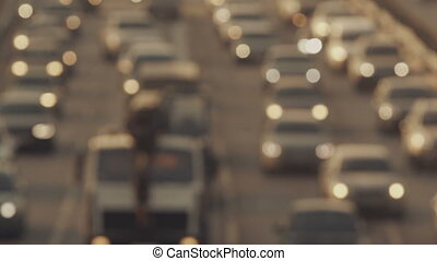 City traffic - Defocusing shot of slow city traffic in the...