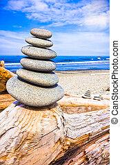 Stack of Rocks Upon Driftwood at Ruby Beach, Washington