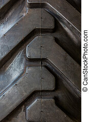 Big tractor rubber tire tread. - Big tractor rubber tire...