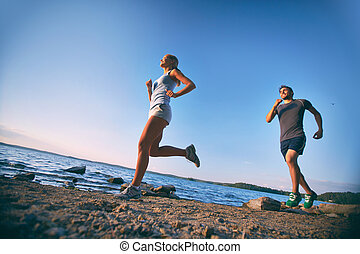 Running dates - Photo of young couple running on the...