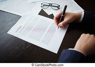 Business deal - Image of businessman hand with pen signing...