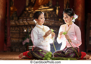 Thai girl making lotus flower in temple, Chiang Mai,...