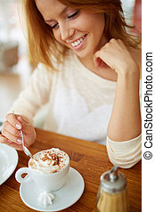 Enjoying dessert - Image of young and pretty woman having...